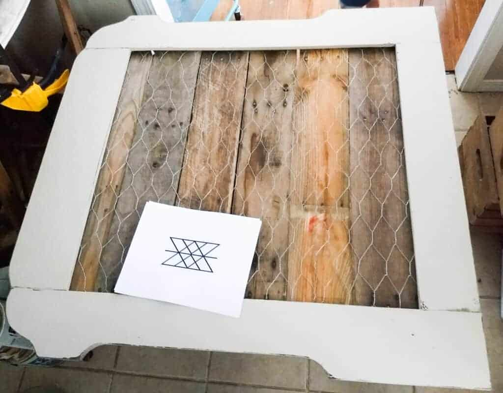 Blank frame with wooden pallet background