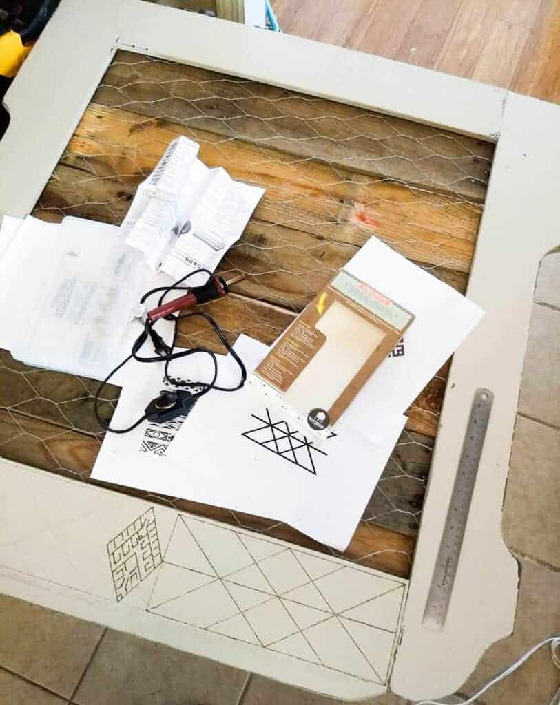 Wooden frame with wood burned design started
