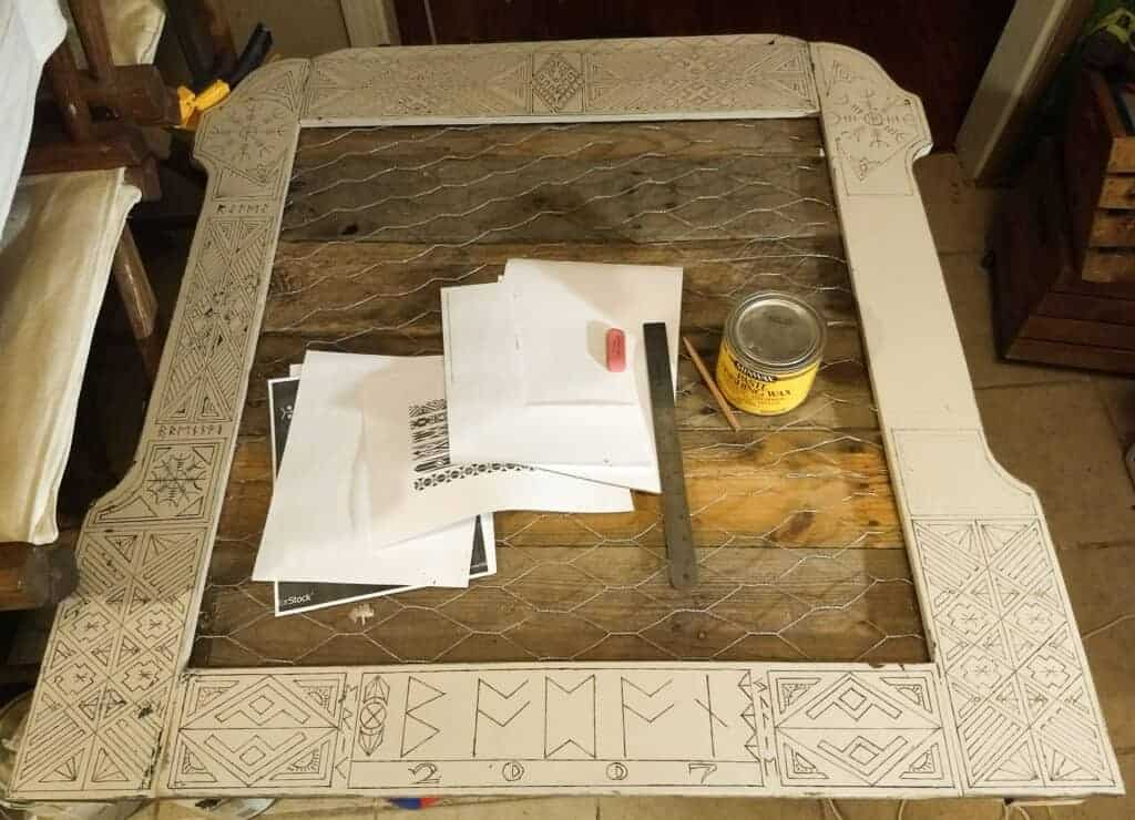 Wooden Frame with drawn designs all over it