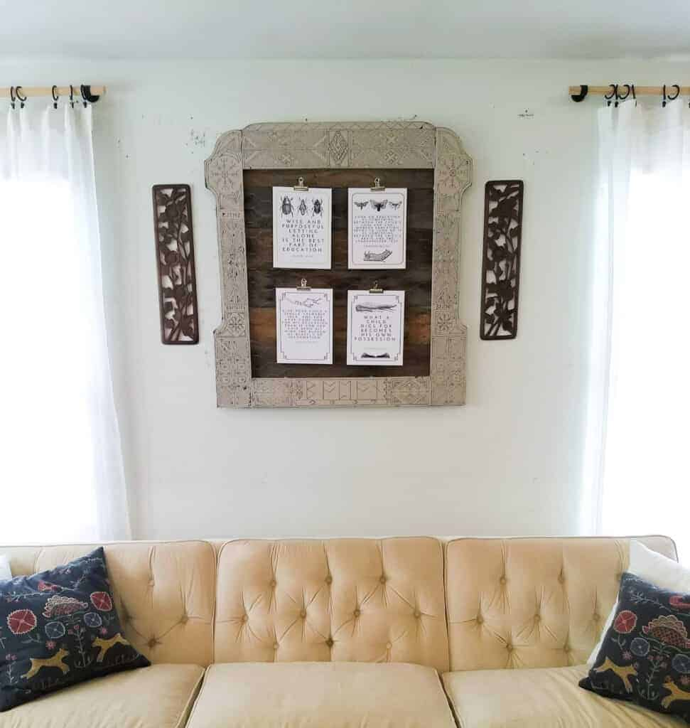 Simple Wood Burned frame above a cream tufted couch