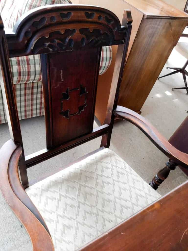 Wooden chair back and seat upholstery up close