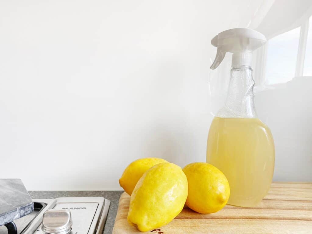 Three Lemons and natural lemon cleaner in a spray bottle. Give a room a refresh with a cleaning.