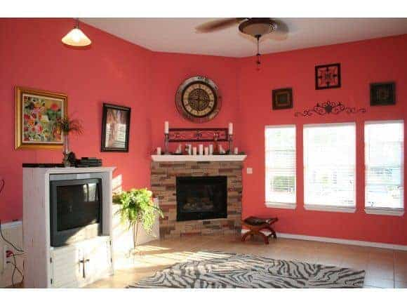 Bright Coral downstairs basement with fireplace and three big windows