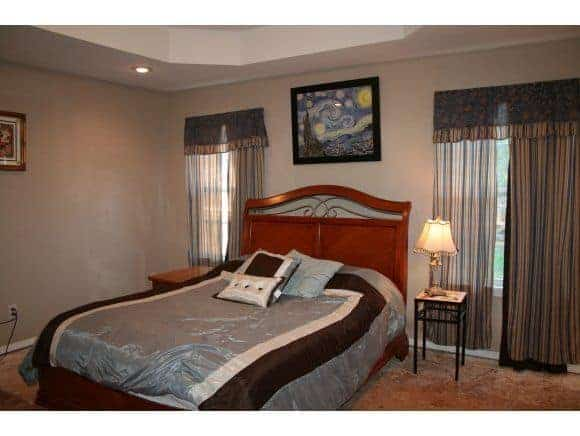 master bedroom with queen size bed and coffer ceiling