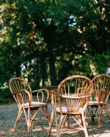 how to make outdated furniture fit your style a pair of patio whicker chairs out in the garden